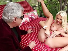 Gorgeous blonde Courtney Taylor with big fake love muffins widens her legs wide ope in front of an aged man. She displays her twat with her pink pants on then has sex with another fellow